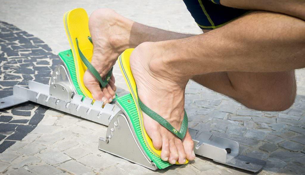 runner wearing flip flops
