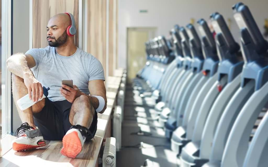 man listening to music after a work out